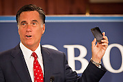 Gov. Mitt Romney compares his economic policies to a iPhone and Obama's to a payphone September 12, 2011 in North Charleston, South Carolina.  Romney toured the new Boeing facility in Charleston and then accepted the endorsement of Gov. Tim Pawlenty during a short visit to the city.
