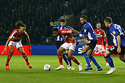 Middlesbrough forward Britt Assombalonga (9) shields the ball from Sheffield Wednesday defender Michael Hector  (34)   during the EFL Sky Bet Championship match between Sheffield Wednesday and Middlesbrough at Hillsborough, Sheffield, England on 19 October 2018.
