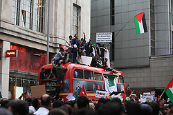 © Licensed to London News Pictures. 11/07/2014. London, UK. Demonstrators concentrate opposite the Embassy of Israel, central London, to stop the bombing of Palestine. The crowd was called by Stop the War coalition among other organizations after the last events in which 25 Palestinians were killed and 70 injured during thebombing campaign in Gaza. The  Photo credit : Isabel Infantes/ LNP