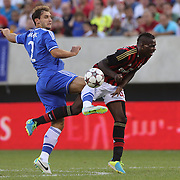 Branislav Ivanovic, Chelsea, (left), tackles Mario Balotelli, AC Milan, during the Chelsea V AC Milan Guinness International Champions Cup tie at MetLife Stadium, East Rutherford, New Jersey, USA.  4th August 2013. Photo Tim Clayton