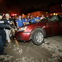 March 31, 2012 - Lexington, Kentucky, USA - University of Kentucky basketball fans upright a car after it had been turned over as they celebrate their team's victory over the University of Louisville in Lexington, Ky., on March 31, 2012. The win for Kentucky advances them to the championship game of the NCAA tournament in New Orleans. Fans took to the streets and in burned couches, turned over a car and ending with a handful of arrests. (Credit image: © David Stephenson/ZUMA Press)