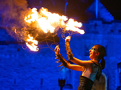 Edinburgh, Scotland, UK. 30th Dec 2019. Edinburgh's famous Hogmanay celebrations get under way with the Torchlight Procession along the historic Royal Mile in Edinburgh's Old Town and ending at Holyrood Park. The procession was led by the Celtic Fire Theatre company, PyroCeltica and the Harbinger Drum Crew. Pictured . Artists from Celtic Fire Theatre perform on Edinburgh Castle Esplanade before the procession. Iain Masterton/Alamy Live News