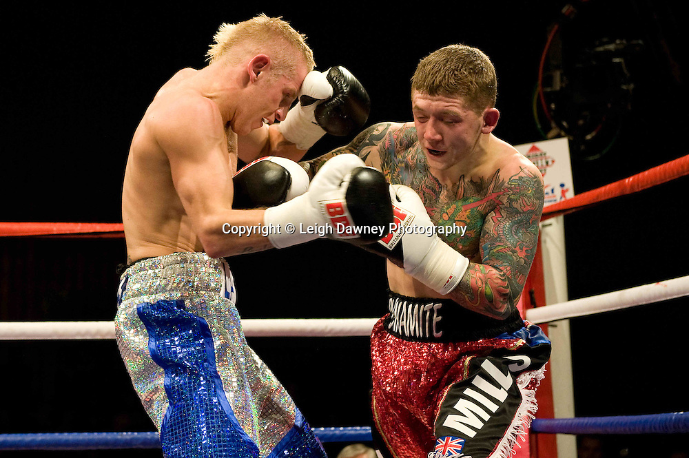 Gary Sykes defeats Dean Mills (red shorts) at the Harvey Hadden Leisure Centre 5th February 2010 Frank Maloney Promotions. Photo credit © Leigh Dawney