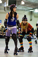 The Supheroes' Bully Julie lines up behind Slamurai of the Rollbots.  The San Diego Derby Dolls were at the Del Mar Fairgrounds in Del Mar, California on November 08, 2008.  The all-female roller derby league, founded in 2005, features serious competition among skaters with tongue-in-cheek names such as Anita Battle and Isabelle Ringer.