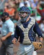Milton catcher Nick Bradshaw reacts as Roswell batter Adam Terrinoni strikes out swinging to end the sixth inning of their GHSA AAAAAA State Baseball Championship game, Monday, May 27, 2013, in Milton, Ga.   David Tulis/AJC Special