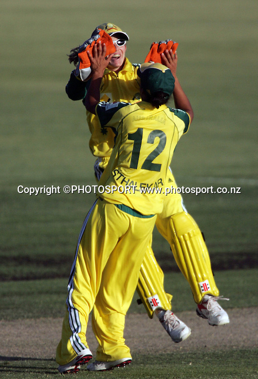 Australia's Julie Hayes and Lisa Sthalekar celebrate winning  the first ODI Rose Bowl cricket match between the White Ferns and Australia at Allan Border Field, Brisbane, Australia, on Friday 20 October 2006. Australia won the match by 2 with a total of 201. Photo: Renee McKay/PHOTOSPORT<br /><br /><br />201006