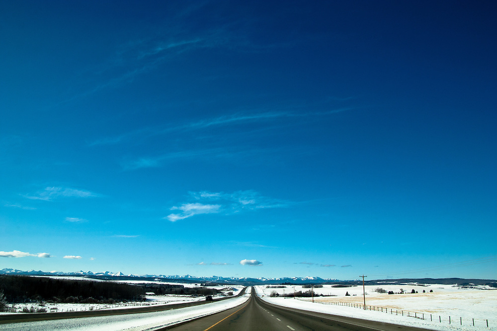 Skies the limit. View looking down a road or highway in awintery calgary scene.