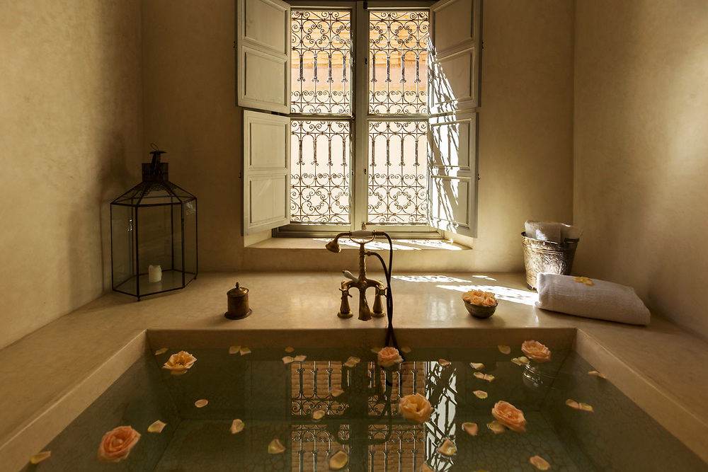 MARRAKESH, MOROCCO - October 21st 2015 - Tadelakt bath with rose flowers at a riad in Marrakesh, Morocco