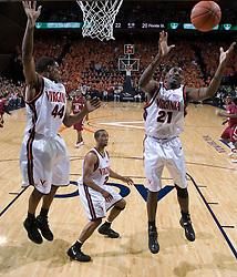 Virginia Cavaliers center Tunji Soroye (21) grabs a rebound in action against FSU.  The Virginia Cavaliers Men's Basketball Team defeated the Florida State Seminoles 73-70 at the John Paul Jones Arena in Charlottesville, VA on February 17, 2007.