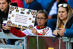 A young Newport County fans holds a sign - Mandatory by-line: Ryan Crockett/JMP - 12/05/2019 - FOOTBALL - One Call Stadium - Mansfield, England - Mansfield Town v Newport County - Sky Bet League Two Play-Off Semi-Final 2nd Leg