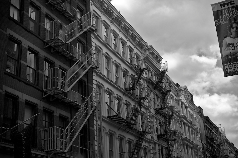 Black and white image of sone buildings in Downtown New York City.