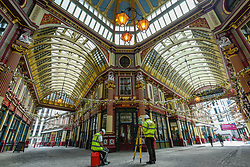 © Licensed to London News Pictures. 10/07/2020. CITY, UK.  Surveyors take advantage of a quiet Leadenhall Market in the City of London to careful laser measurements.  The historical market would normally be crowded with city workers on a Friday lunchtime but the coronavirus pandemic has left the venue largely unattended as people continue work from home.  The future definition of the workplace may be a hybrid of office work and working from home, resulting in a probable reduction in people working in the area.  Photo credit: Stephen Chung/LNP
