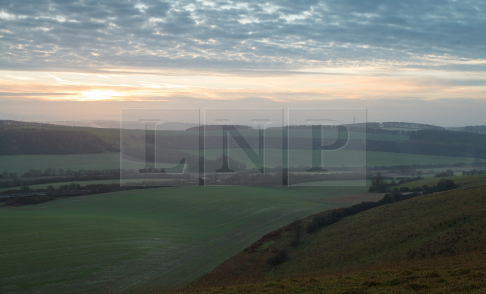 © Licensed to London News Pictures. 25/01/2014. Hampshire, UK. Sunrise over the North Wessex Downs in Hampshire today (25/01/2014). Strong winds and rain are forecast for the weekend. Photo credit : Rob Arnold/LNP