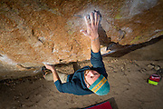 Derrick Krause projecting the crux of Center Direct, v10.<br /> The Buttermilks, California
