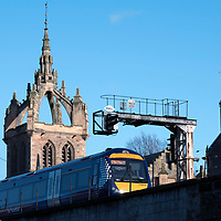 A Perth to Dundee train passes St Leonards in the Field Church, Perth<br />Picture by Graeme Hart.<br />Copyright Perthshire Picture Agency<br />Tel: 01738 623350  Mobile: 07990 594431
