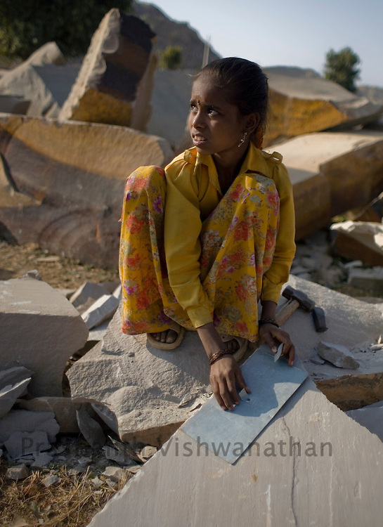 PRASHANTH VISHWANATHAN, INDIA - DECEMBER 18: Santosh a seven year old girl trains at a stone quarry in Dabi near Kota, in Rajasthan,  India.(Photo by Prashanth Vishwanathan/Getty Images for the Forbes)