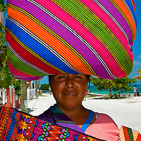 Masyan woman was selling weavings on a beach at Caye Caulker, Belize.