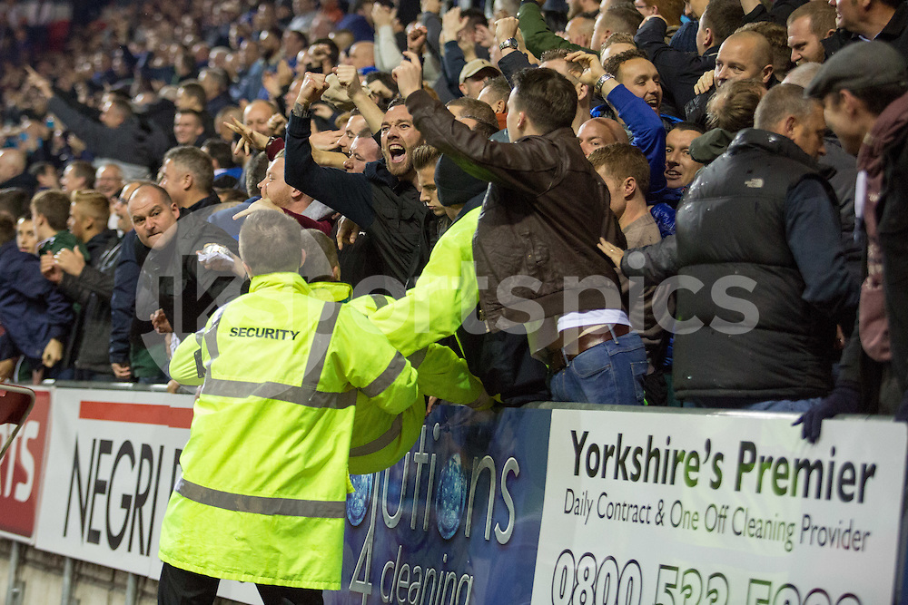Rotherham Stewards struggle to contain Sheffield Wednseday fans celebrating goals from Lucus Joao and Fernando Forestieri  during the Sky Bet Championship match between Rotherham United and Sheffield Wednesday at the Aesseal New York Stadium, Rotherham, England on 23 October 2015. Photo by James Williamson.