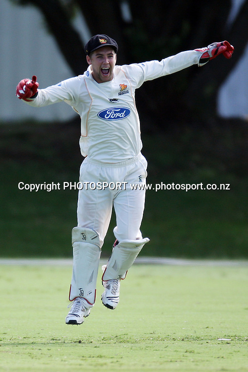 Wicket keeper Joe Austin-Smellie celebrates taking a catch, Plunket Shield, 4 day domestic cricket. Auckland Aces v Wellington Firebirds, Colin Maiden Park, Auckland. 23 March 2011. Photo: William Booth/photosport.co.nz