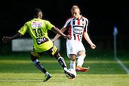 03-07-2015 VOETBAL:CHARLEROI:WILLEM II:DOORWERTH<br /> <br /> Dico Koppers van Willem II in duel met Clinton Mata<br /> foto: Geert van Erven