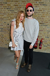 SIENNA MILLER and TOM STURRIDGE at a summer drinks party hosted by Bec Astley Clarke at the Serpentine Sackler Gallery, Hyde Park, London on 17th June 2014.