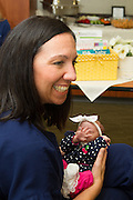 Nurse Manager, Angela Carlson holds former NICU patient, Zyan Misenheimer.  The baby was born at Round Rock Medical Center at 33 weeks gestation.