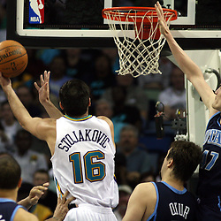 New Orleans Hornets forward Peja Stojakovic #16 shoots as Andrei Kirilenko #47 of the Utah Jazz tries to block the ball in the third quarter of their NBA game on April 8, 2008 at the New Orleans Arena in New Orleans, Louisiana. The Utah Jazz defeated the New Orleans Hornets 77-66.