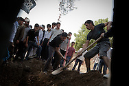 The funeral for an FSA soldier is held in southern Turkey, after he died from injuries sustained during a battle with the Syrian army near Lattakia. Despite making it to the Turkish border, he later died in hospital in Antakya. Yayladagi, Turkey. 08/06/2012