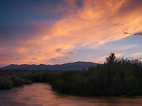 """Sierra Wave over Owens River, Owens Valley, California<br /> <br /> Backstory:<br /> Having been inspired by the late, great Galen Rowell, I made my first trip to the Eastern Sierra in 2004. Known as """"The Range of Light"""", the Sierra Nevada did not disappoint as my friend and I were treated to one of the most incredible sunsets that I have ever seen. This giant lenticular cloud is also known informally known as a """"Sierra Wave"""".<br /> <br /> Year Photographed: 2004"""