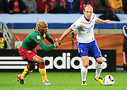 CAPE TOWN, SOUTH AFRICA- Thursday 24 June 2010, Arjen Robben gets pulled by Rigobert Song during the match between the Netherlands (Holland) and Cameroon held at the new Cape Town Stadium in Green Point during the 2010 FIFA World Cup..Photo by Roger Sedres/Image SA