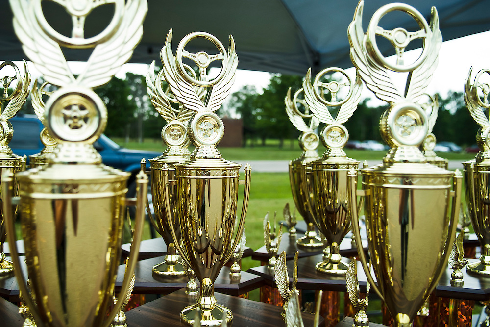 Lathan Goumas | MLive.com..Trophies sit on a table during the Shriner's 9th Annual Classic Car Show on Sunday in Clio.