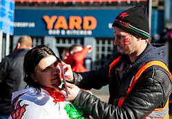 A fan having face paint applied<br /> <br /> Photographer Simon King/Replay Images<br /> <br /> Six Nations Round 1 - Wales v Italy - Saturday 1st February 2020 - Principality Stadium - Cardiff<br /> <br /> World Copyright © Replay Images . All rights reserved. info@replayimages.co.uk - http://replayimages.co.uk