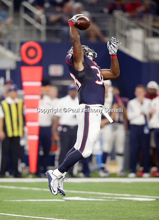 Houston Texans rookie running back Kenny Hilliard (38) leaps as he tries to catch an incomplete second quarter pass during the 2015 NFL preseason football game against the Dallas Cowboys on Thursday, Sept. 3, 2015 in Arlington, Texas. The Cowboys won the game 21-14. (©Paul Anthony Spinelli)