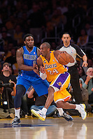 02 April 2013: Guard (24) Kobe Bryant of the Los Angeles Lakers drives to the basket while being guarded by Jae Crowder of the Dallas Mavericks during the first half of the Lakers 101-81 victory over the Mavericks at the STAPLES Center in Los Angeles, CA.