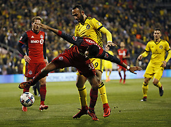November 21, 2017 - Columbus, OH, USA - Columbus Crew forward Justin Meram (9) and Toronto FC defender Steven Beitashour (33) fight for a ball during the first half of the first leg of the MLS Eastern Conference finals at MAPFRE Stadium in Columbus, Ohio, on Tuesday, Nov. 21, 2017. (Credit Image: © Adam Cairns/TNS via ZUMA Wire)