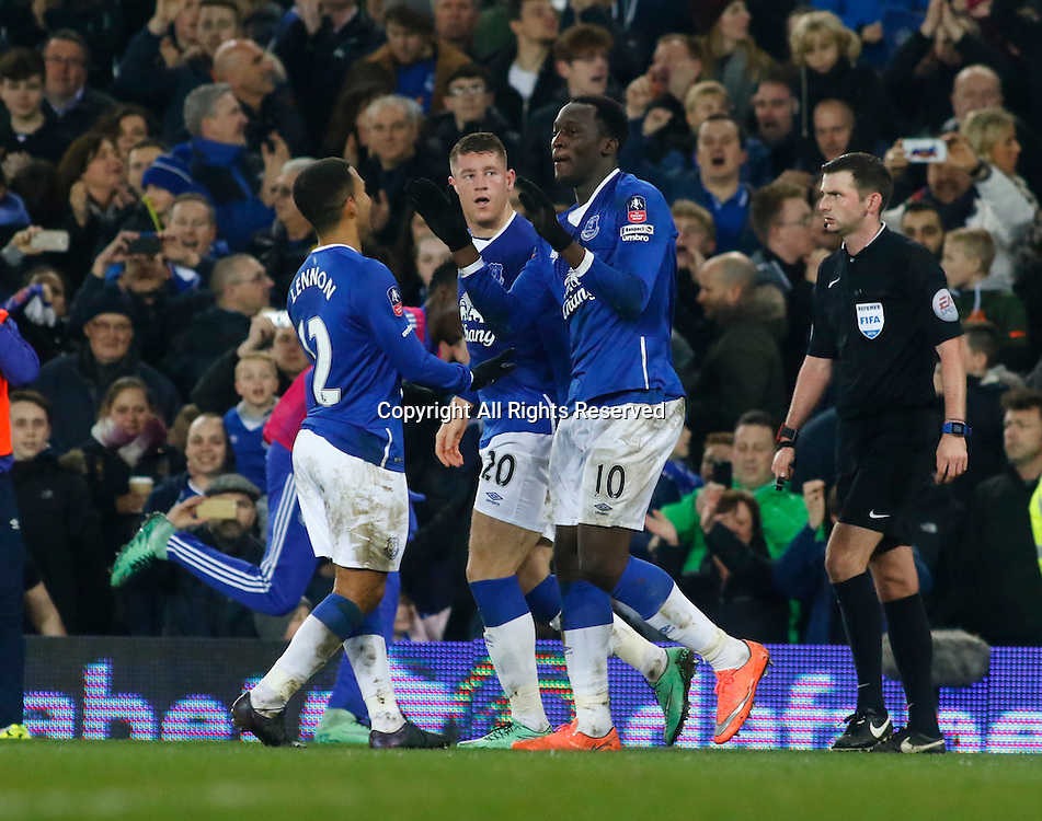 12.03.2016. Goodison Park, Liverpool, England. Emirates FA Cup 6th Round. Everton versus Chelsea. Everton striker Romelu Lukaku is congratulated by his team mates after scoring his team's first goal.