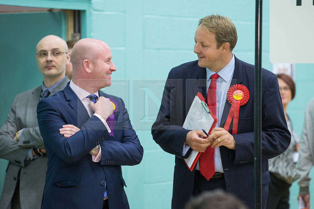 © Licensed to London News Pictures . 09/10/2014 . Heywood , UK . Paul Nuttall MEP of UKIP and Toby Perkins MP of Labour chat  at the Heywood and Middleton by-election count which is taking place following the death of sitting MP Jim Dobbin . Photo credit : Joel Goodman/LNP
