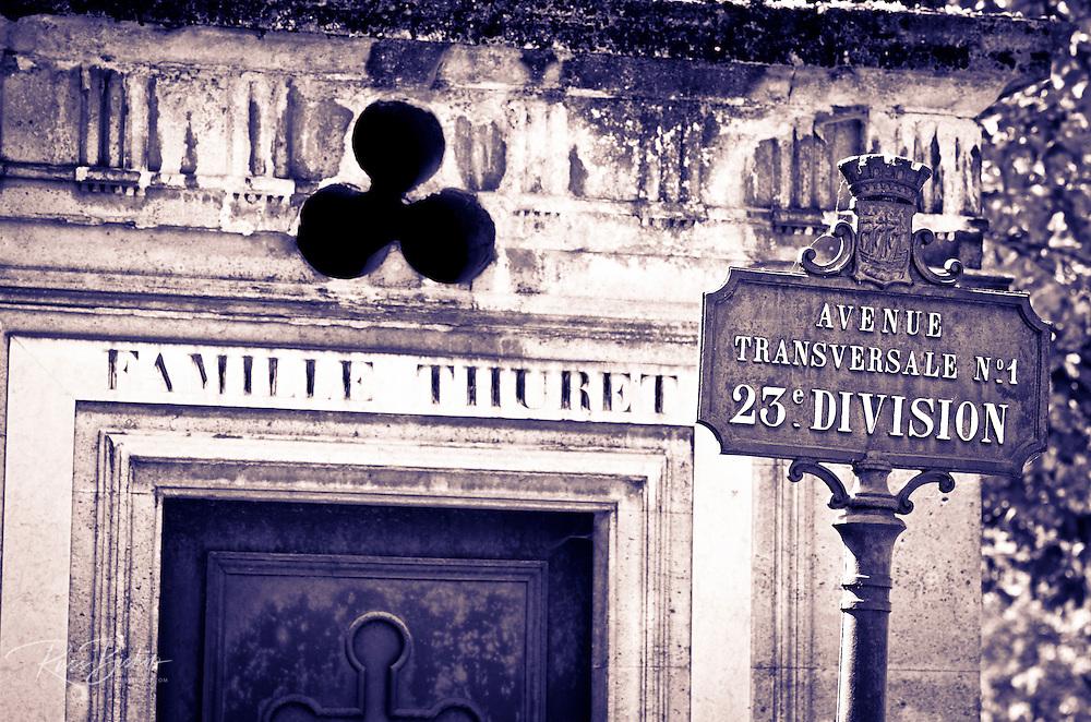Street sign and mausoleum at Père Lachaise Cemetery, Paris, France