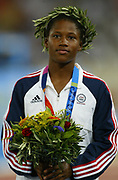 Lauryn Williams of the United States receives silver medal after placing second in the women's 100 meters in 10.96 in the 2004 Olympics in Athens, Greece on Saturday, August 21, 2004.