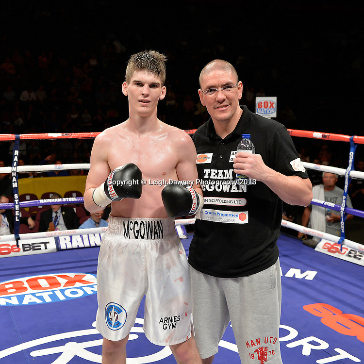 Macaulay McGowan (pictured with trainer) defeats Matt Seawright in a welterweight contest on 26th July 2014 at the Phones 4U Arena, Manchester. Promoted by Frank Warren. © Credit: Leigh Dawney Photography.