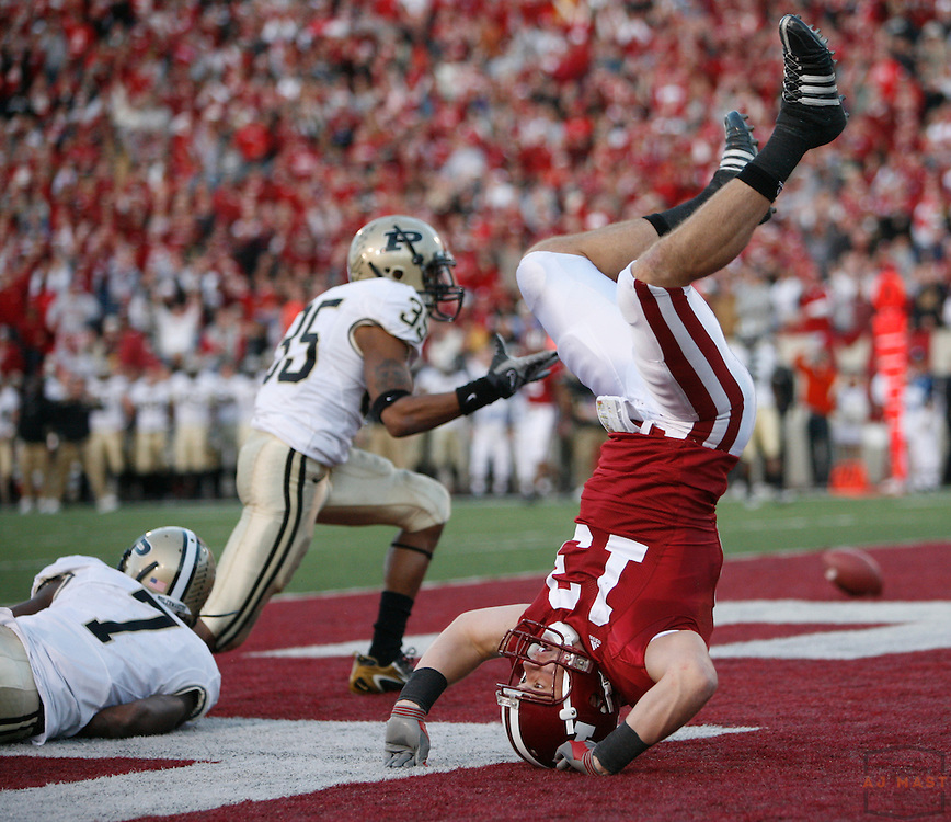 17 November 2007: Indiana wide receiver Andrew Means (13) is upendedd as the Indiana Hoosiers played the Purude Boilermakers in a college football game in Bloomington, Ind. Indiana won 27-24.