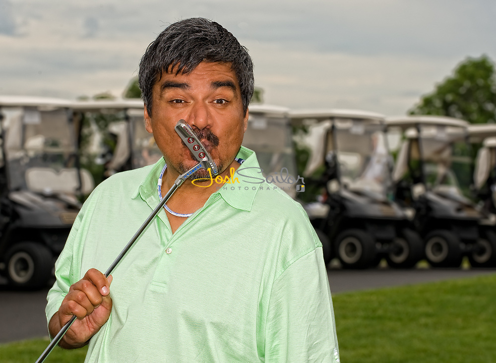 George Lopez Kissing His Golf Iron