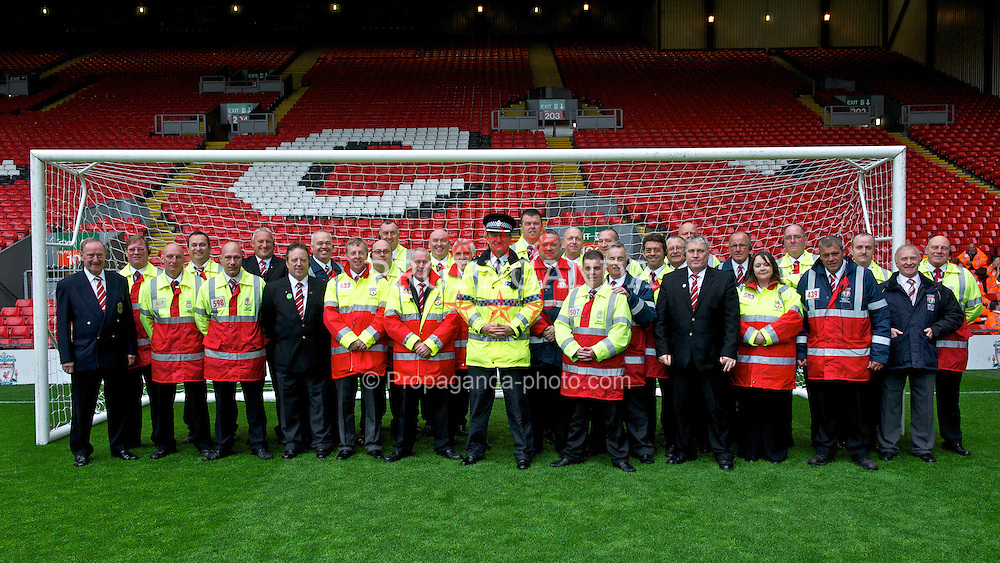 LIVERPOOL, ENGLAND - Sunday, May 15, 2011: Liverpool's match-day stewards say farewell to retiring police chief Bernie Swift during the Premiership match at Anfield. (Photo by David Rawcliffe/Propaganda)