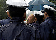 A Japanese nationalist is prevented by police from attacking people protesting of a proposed visit to controversial Yasukuni Shrine by Japan's prime minister in Tokyo, Japan. very year on August 15, the day Japan officially surrendered in WWII, tens of thousands of Japanese visit the controversial shrine to pay their respects to the 2.46 million war dead enshrined there, the majority of which are soldiers and others killed in WWII and including 14 Class A convicted war criminals, such as Japan's war-time prime minister Hideki Tojo. Each year speculation escalates as to whether the country's political leaders will visit the shrine, the last to do so being Junichiro Koizumi in 2005. Nationalism in Japan is reportedly on the rise, while sentiment against the nation by countries that suffered from Japan's wartime brutality, such as China, has been further aggravated by Japan's insistence on glossing over its wartime atrocities in school text books...Photographer:Robert Gilhooly..