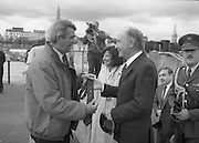 Round Europe Yacht Race.   (R61)..1987..25.07.1987..07.25.1987..25th July 1987..President Patrick Hillery started the Round Europe Yacht Race which began at Dun Laoghaire today...President Hillery is presented with a tie to commemorate his starting of the round Europe yacht Race.