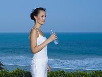 woman caucasian driking water by the seaside