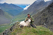 Successful Dall Sheep Hunter with Ram in a Beautiful Alaskan Valley