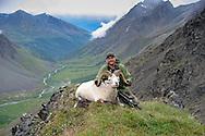 Successful Dall Sheep Hunter with Ram in a Beautiful Alaskan Valley