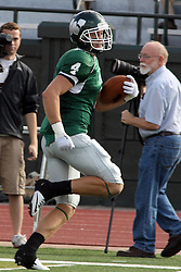 12 October 2013:  Tate Musselman hoofs it left turning and heads up the home sideline during an NCAA division 3 football game between the North Park vikings and the Illinois Wesleyan Titans in Tucci Stadium on Wilder Field, Bloomington IL