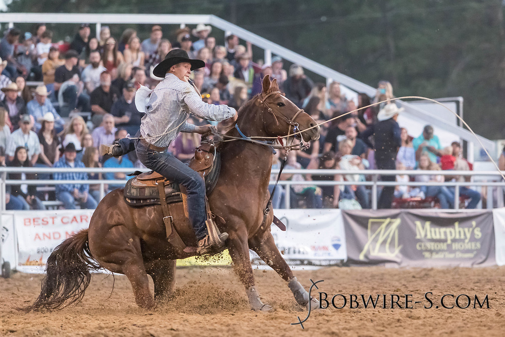 Tie-down roper Brady Thurston makes his run during the second performance of the Elizabeth Stampede on Saturday, June 2, 2018.